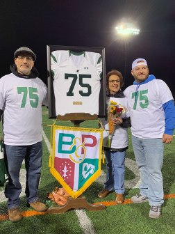 The DeFeo Family with Ken DeFeo's retired football jersey