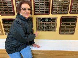 Ken DeFeo's mother with the memorial plaque